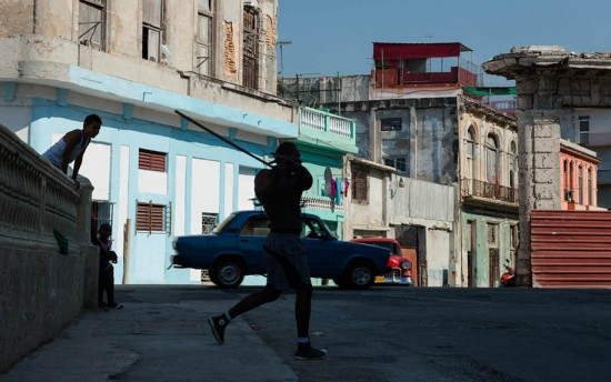 Havana, Cuba: Teenagers play baseball with a bottle cap and stick