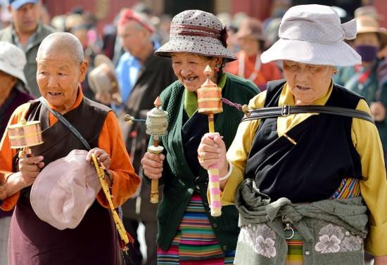 Tibetans walking around the Jokhang Monastery