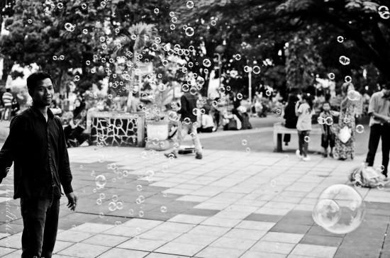 "The bubble vendor in Bukittinggi's ""Jam Gadang"" (clock tower) square."