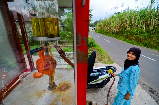 Most women in Sumatra wear pyjamas for clothes. It's quite bizarre. This is someone's front yard mini-petrol station. Quite professional when compared with the racks of glass bottles in most of Indonesia.