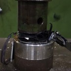Nikon-Coolpix-P300-camera-getting-crushed-by-a-hydraulic-press-2