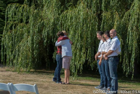 Two friends embrace before the bride walks the isle