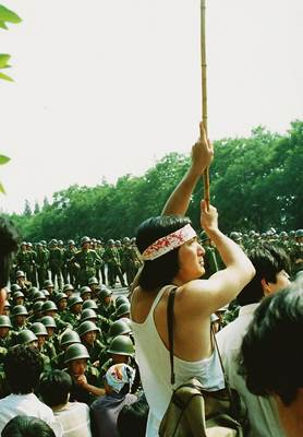 A defiant protester confronting soldiers at the edge of Tiananmen Square June 3, 1989. Photo by Terril Jones.