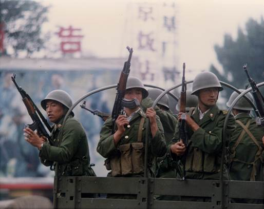 Soldiers patrol a street just east of Tiananmen Square, June 4, 1989. Photo by Terril Jones/AP.
