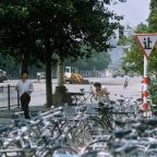 "Bystanders flee tanks approaching from Tiananmen Square June 5, 1989. At center left between the trees in the background is the man in the white shirt who stopped the line of tanks in the well-known photos, dubbed ""Tank Man."" Photo by Terril Jones/AP."