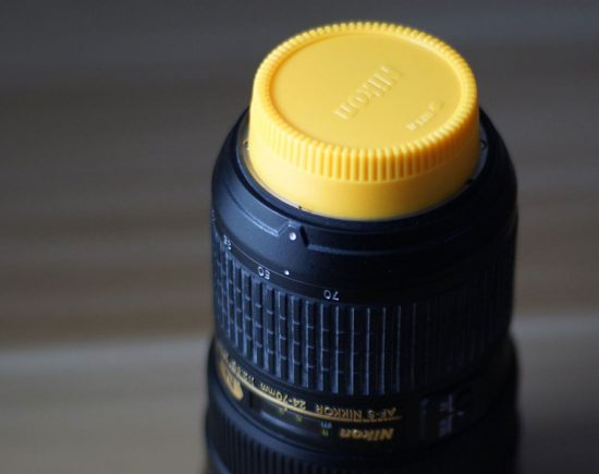 This yellow lens cap for Nikon F-mount is $1.25